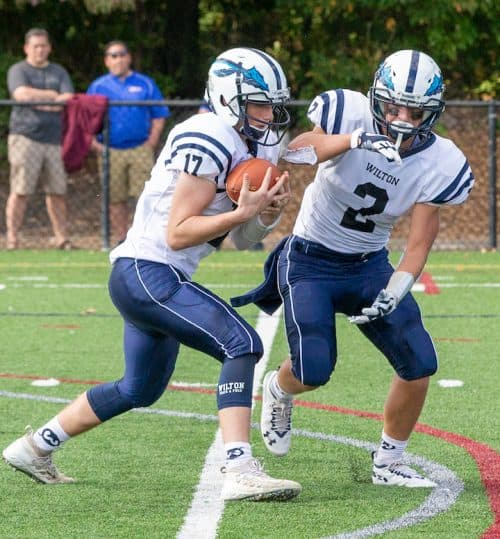 Jimmy O'Brien (left) threw three touchdown passes in Wilton's 41-8 rout of Central on Friday night. — GretchenMcMahonPhotography.com