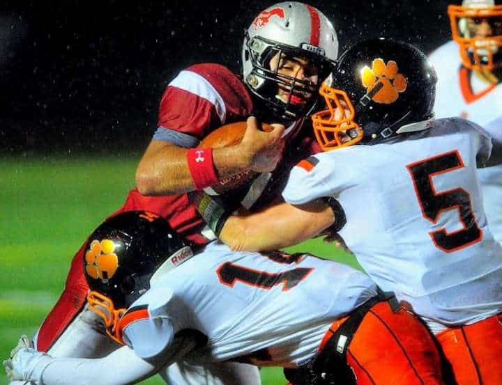 James Isaacson (#14) and Ben Seward (#5) combine to stop a Warde player in Friday night's game. — Christian Abraham photo