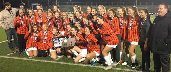 The Ridgefield High girls soccer team celebrates its 1-0 win over Staples in the Class LL state finals. — Tim Murphy photo