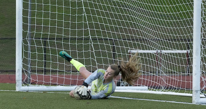 Erynn Floyd secured Wilton's 2-1 upset win over St. Joseph with this save in the second round of penalty kicks. — GretchenMcMahonPhotography.com